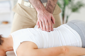 Young woman in the middle of massage therapy